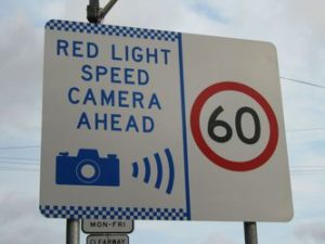 Signage indicating red-light and speed cameras in Australia